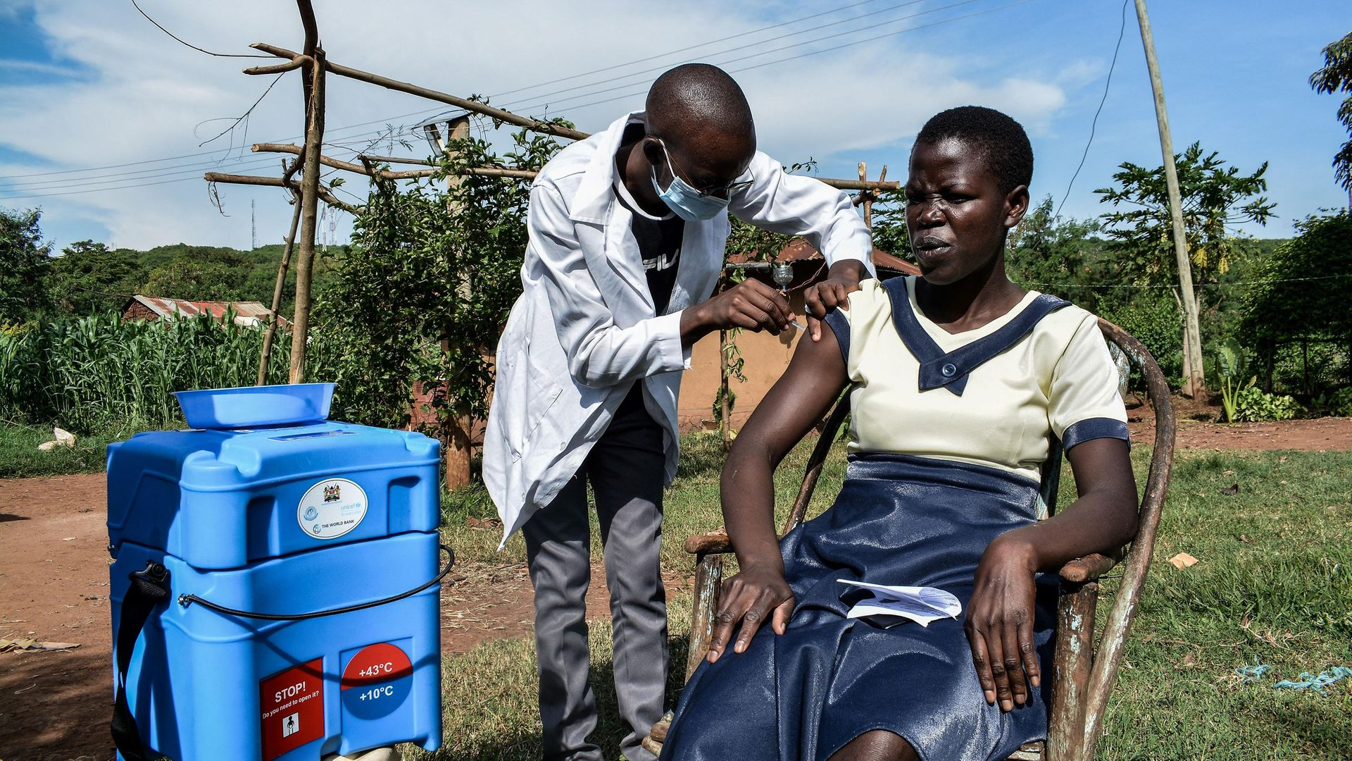 A health worker injects a woman with the Oxford/AstraZeneca Covid-19 vaccine during door-to-door visits in Siaya, Kenya - Credit: AFP via Getty Images