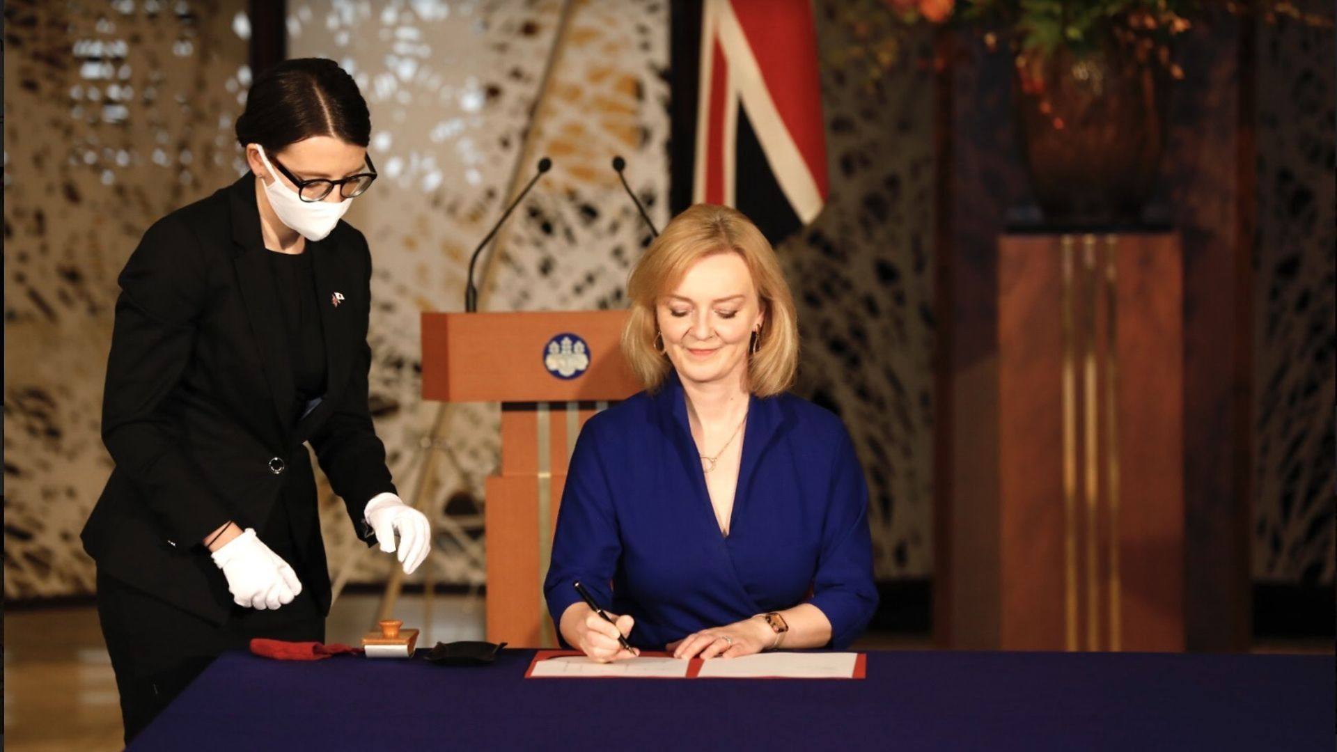 Liz Truss signing a trade deal - Credit: PA