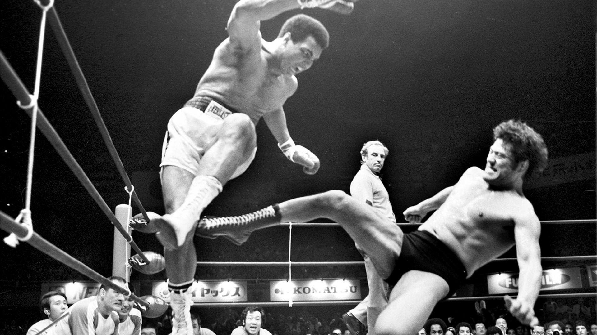 Muhammad Ali takes evasive action from a kick from Antonio Inoki during their bizarre 1976 clash - Credit: Getty Images