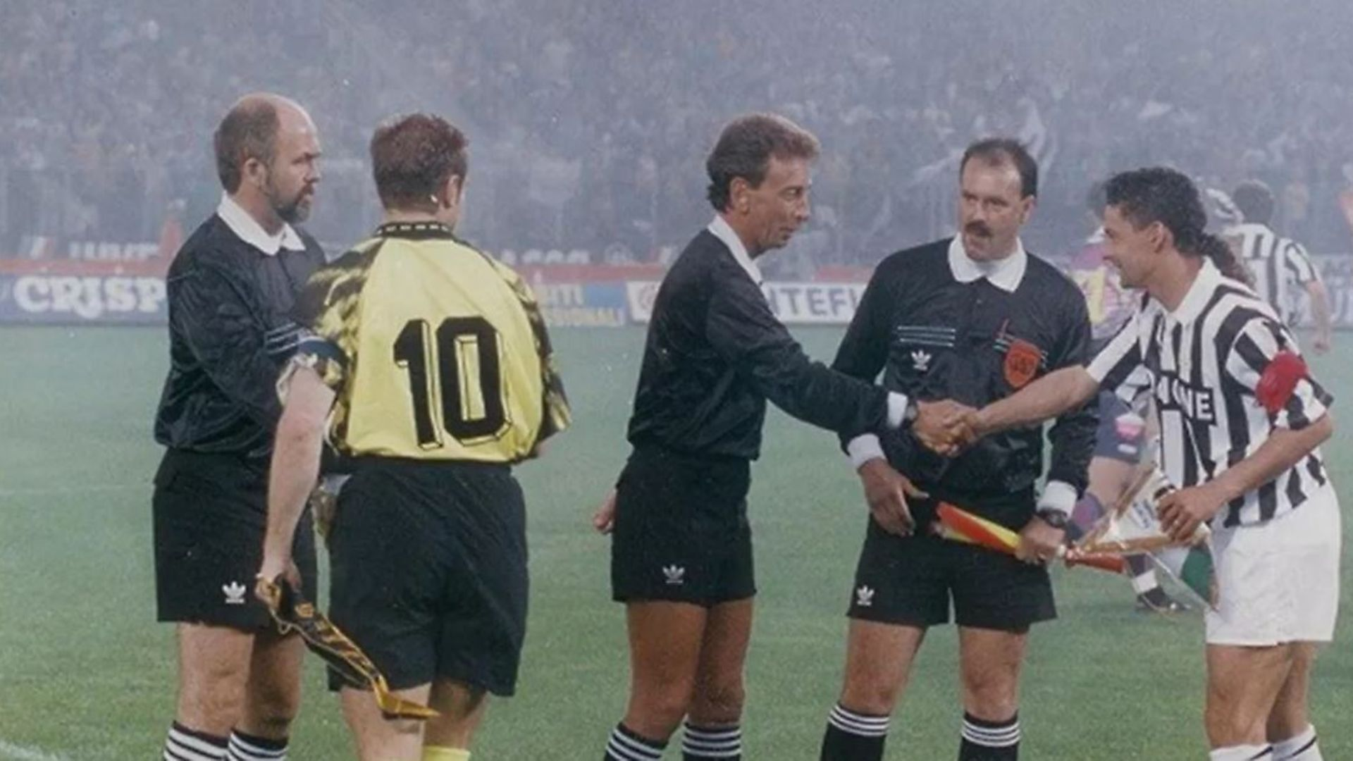 John Blankenstein shakes hands with Roberto Baggio at the start of the 1993 Uefa Cup final between Juventus and Borussia Dortmund - Credit: John Blankenstein Foundation