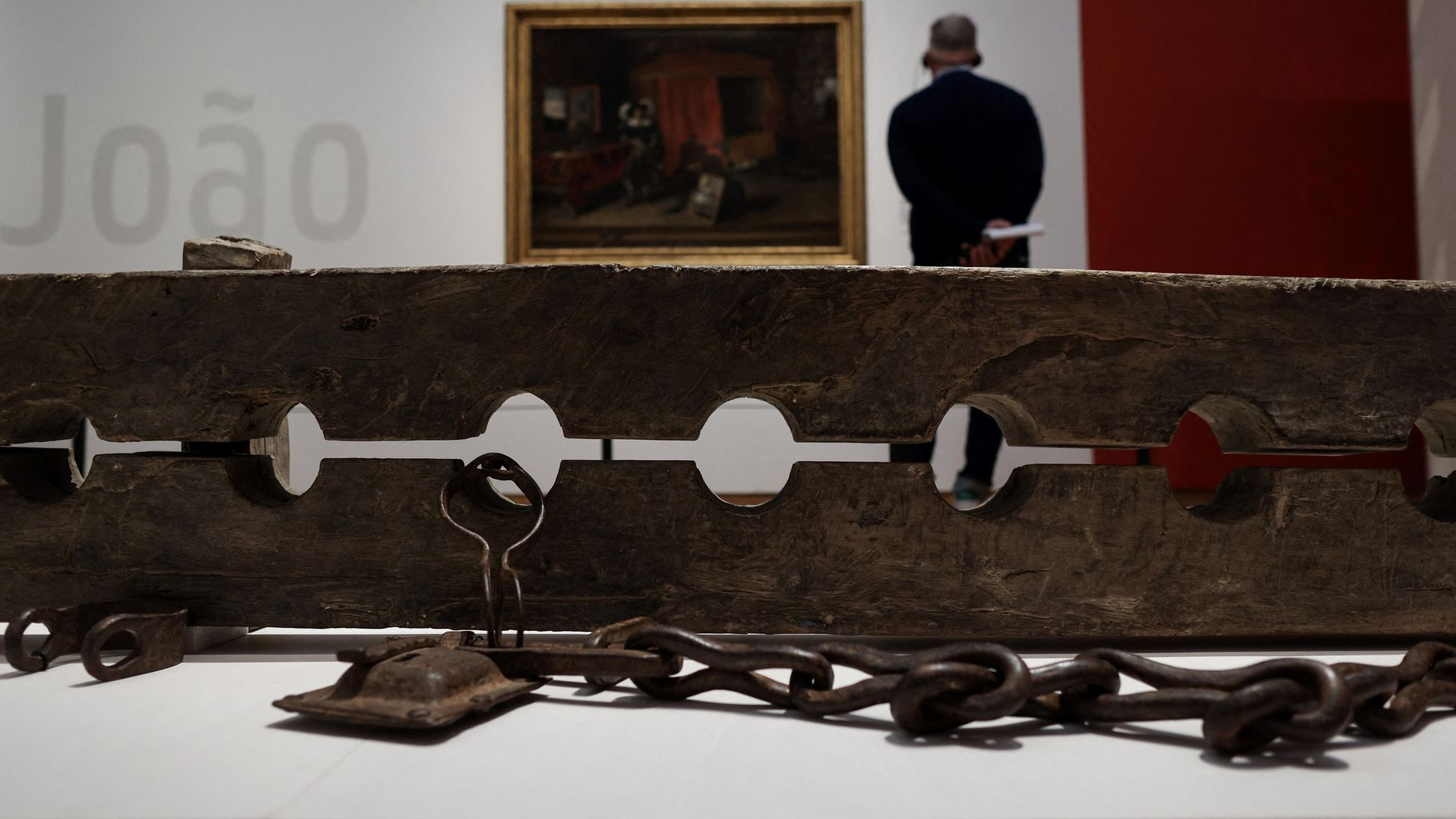 Multiple foot stocks for constraining ensclaved people, as seen in the slavery exhibition at Amsterdam's Rijksmuseum - Credit: Photo by KENZO TRIBOUILLARD/AFP via Getty Images