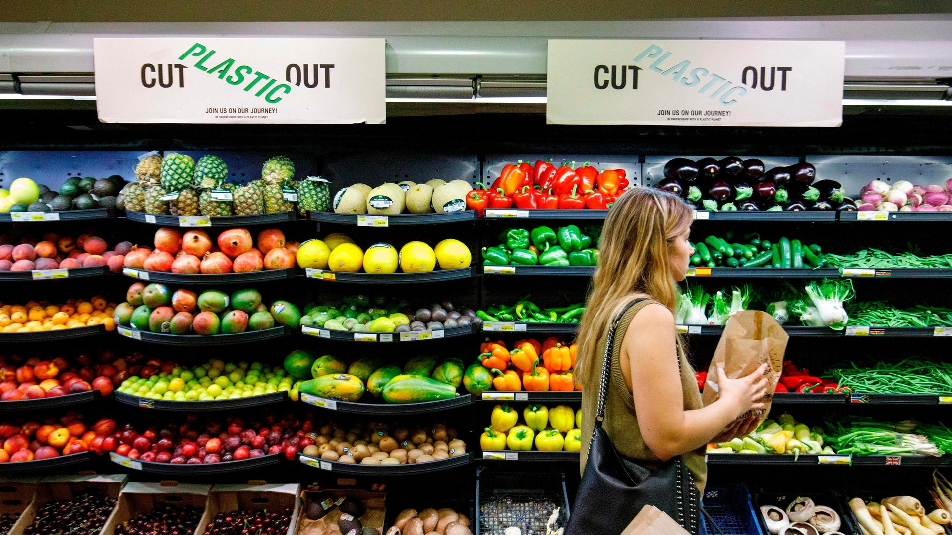 A shopper browsing in a Belsize Park supermarket, north London - Credit: AFP via Getty Images