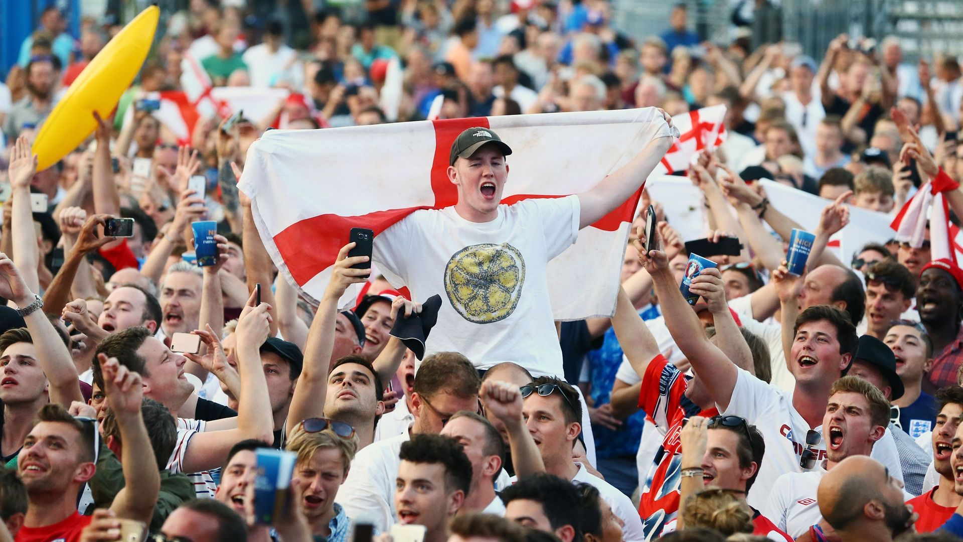 England fans sing the national anthem in the fan zone in Nice, France during Euro 2016 - Credit: PA