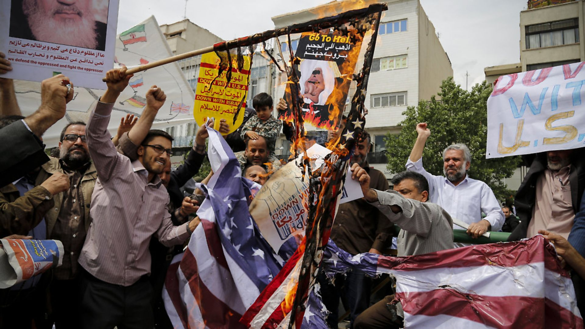Iranian demonstrators burn American flags during a protest in Tehran, Iran on May 11, 2018, following the decision by U.S. President Donald Trump to pull out of the nuclear deal and renew sanctions on the country. - Credit: PA Images