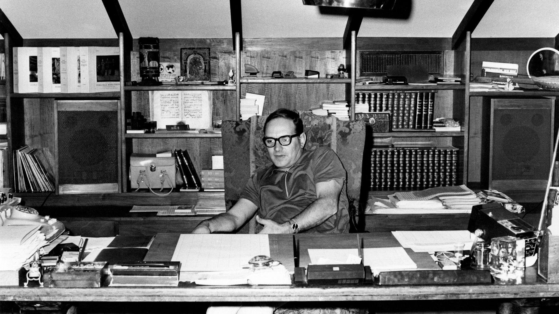 Ennio Morricone in his office in Rome in the 1970s - Credit: Mondadori via Getty Images