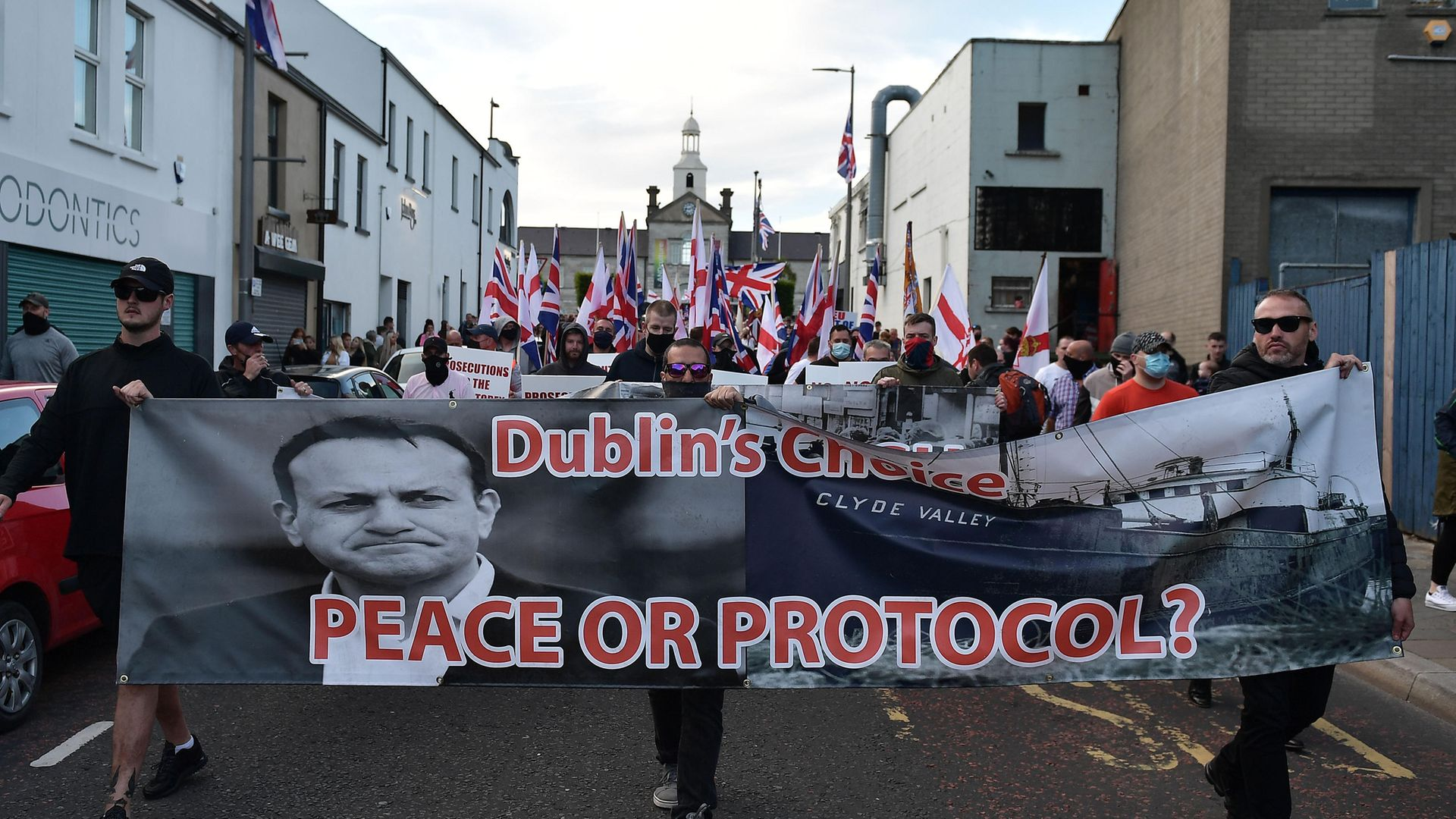Loyalist band members and supporters make their way through Newtownards town centre following an anti-Northern Ireland Protocol protest rally in June 2021 - Credit: Getty Images