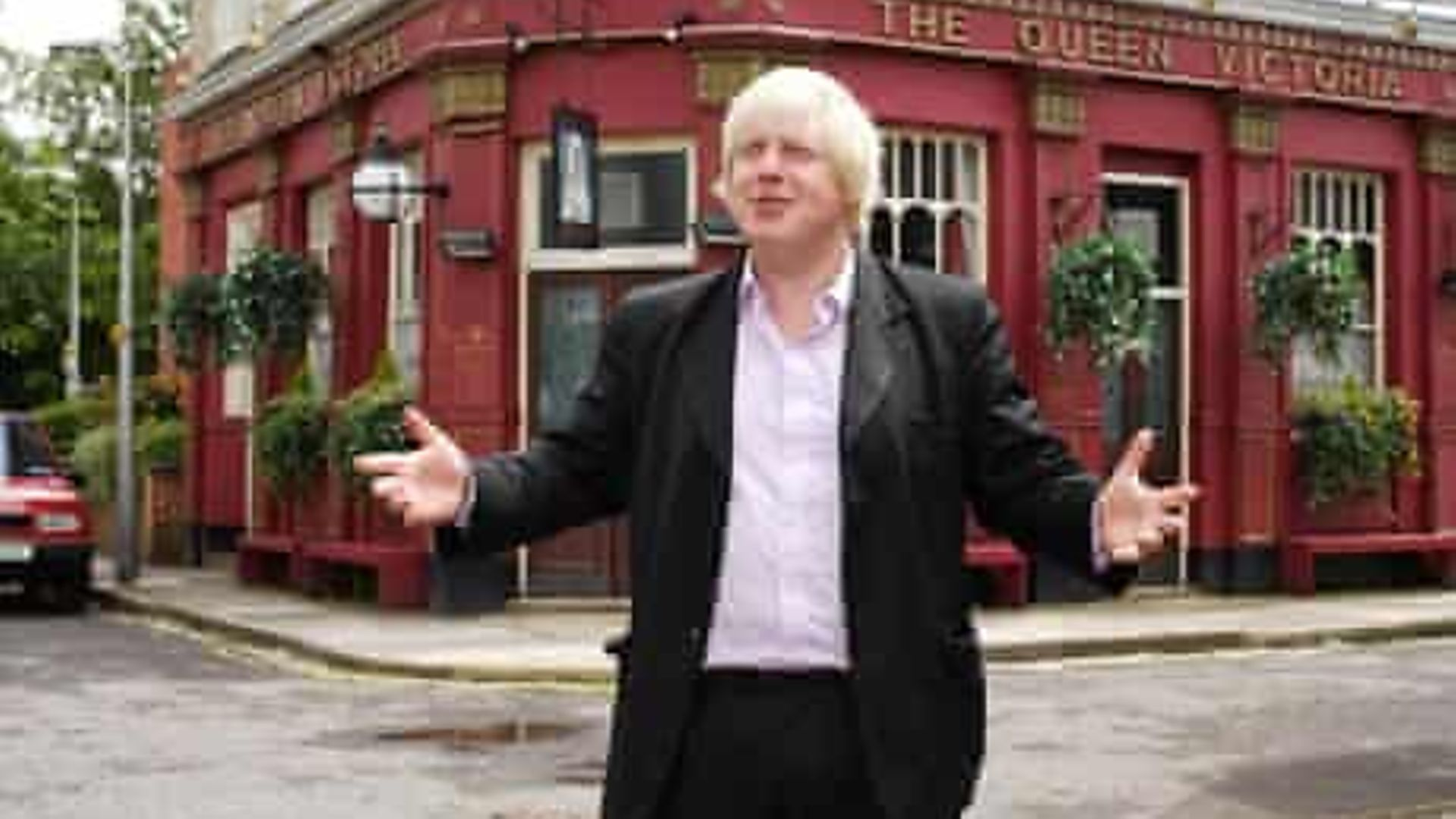 Boris Johnson in front of the Queen Vic in Albert Square in 2009, when he made a cameo appearance on EastEnders - Credit: BBC