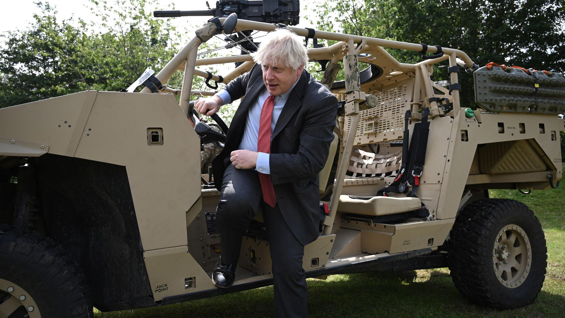 Boris Johnson steps down from an armoured vehicle during a trip to Aldershot garrison on June 24, 2021 - Credit: Getty Images