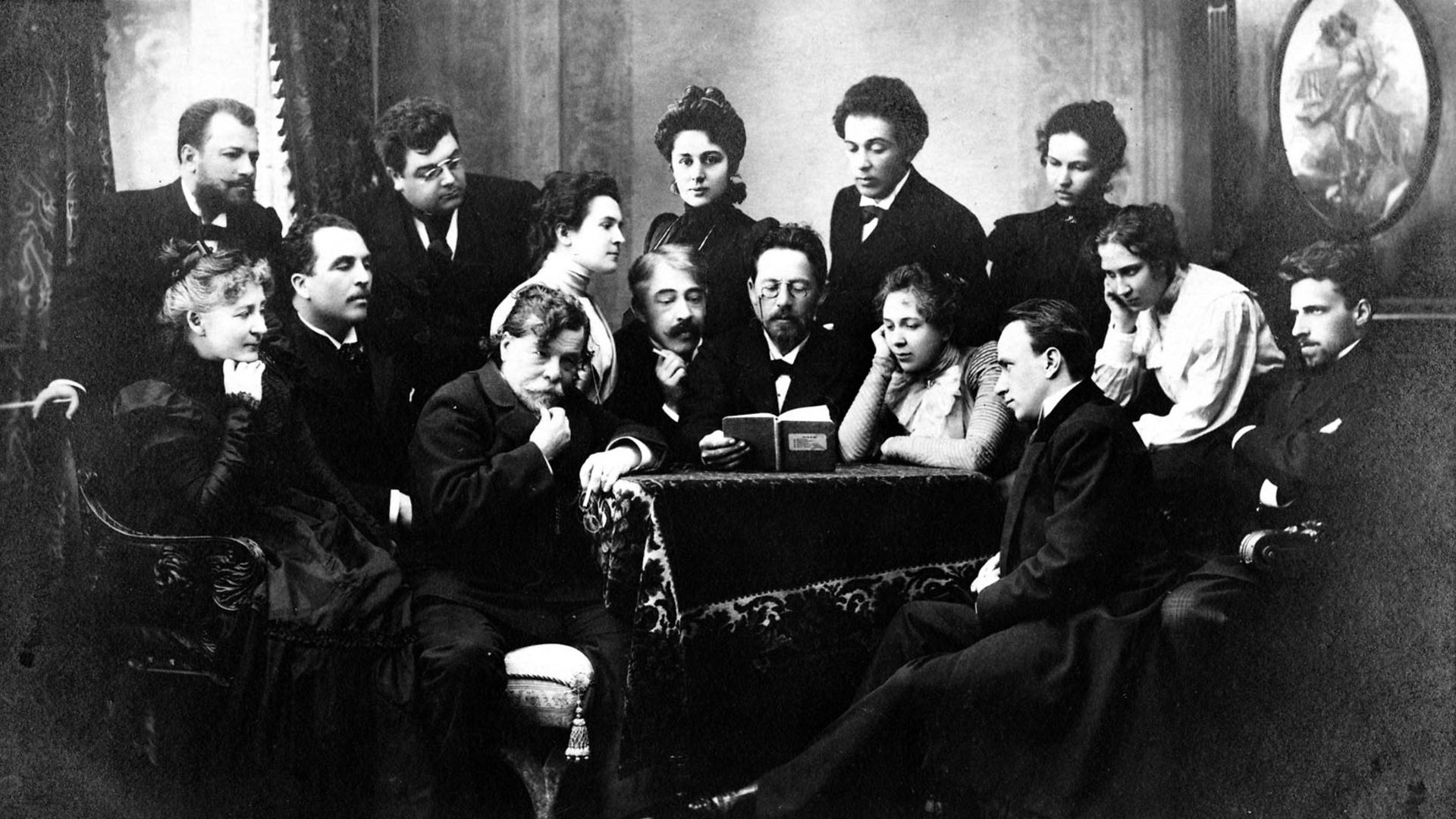 Anton Chekhov, in the centre, reads a script to actors from the Moscow State Art Theatre in 1898 - Credit: Getty Images