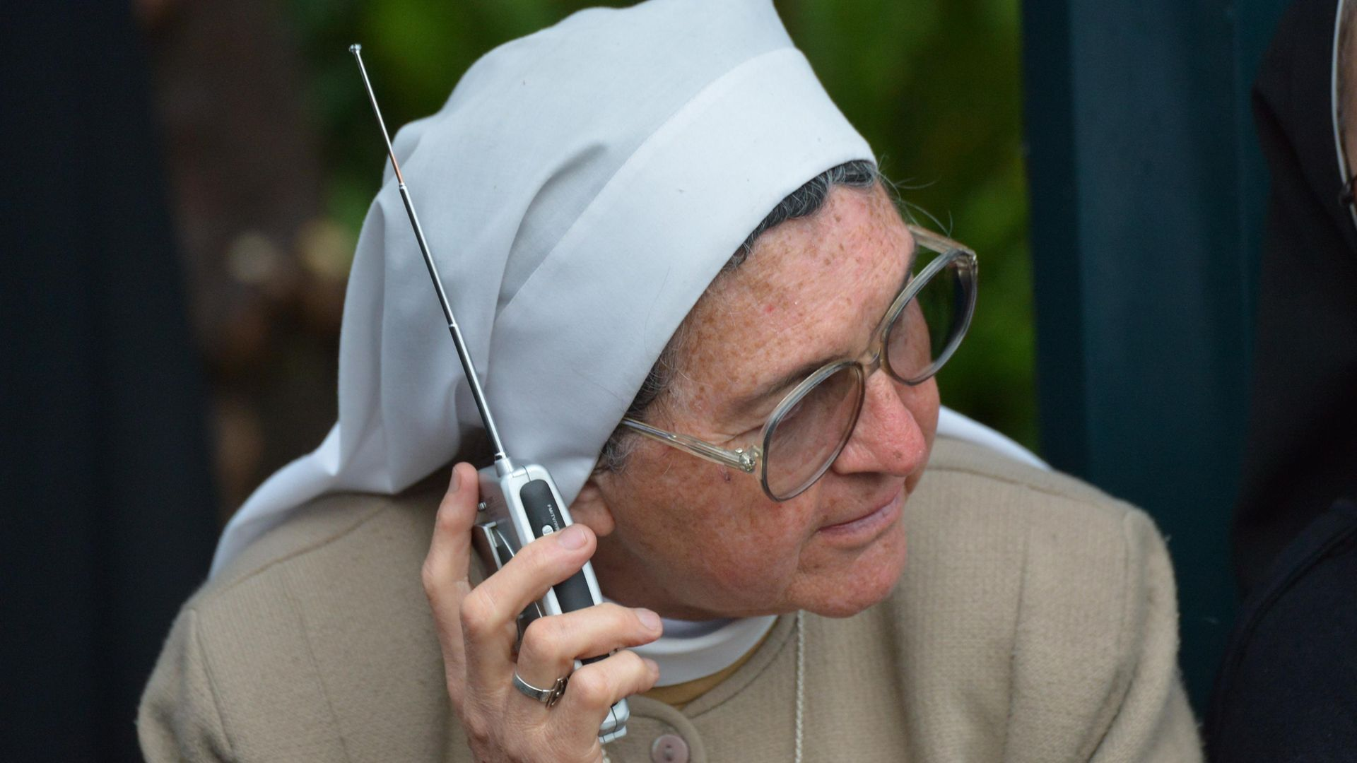 A nun listens to the radio in Ecuador, ahead of a 2015 visit by Pope Francis - Credit: Photo: Martin Bernett/AFP via Getty Images
