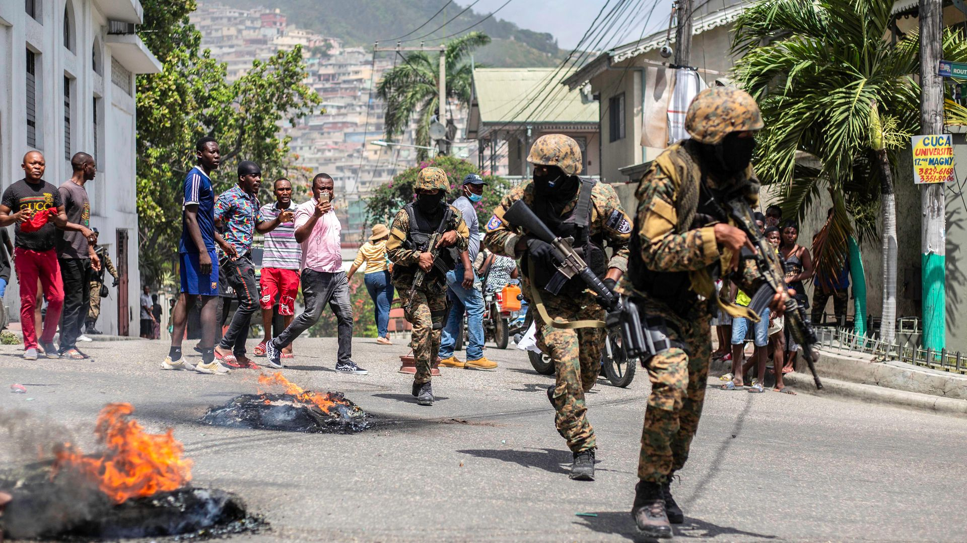 Unrest flares near the police station in Petion Ville after the murder of Haitian president Jovenel Moise in the neighbourhood - Credit: Getty Images