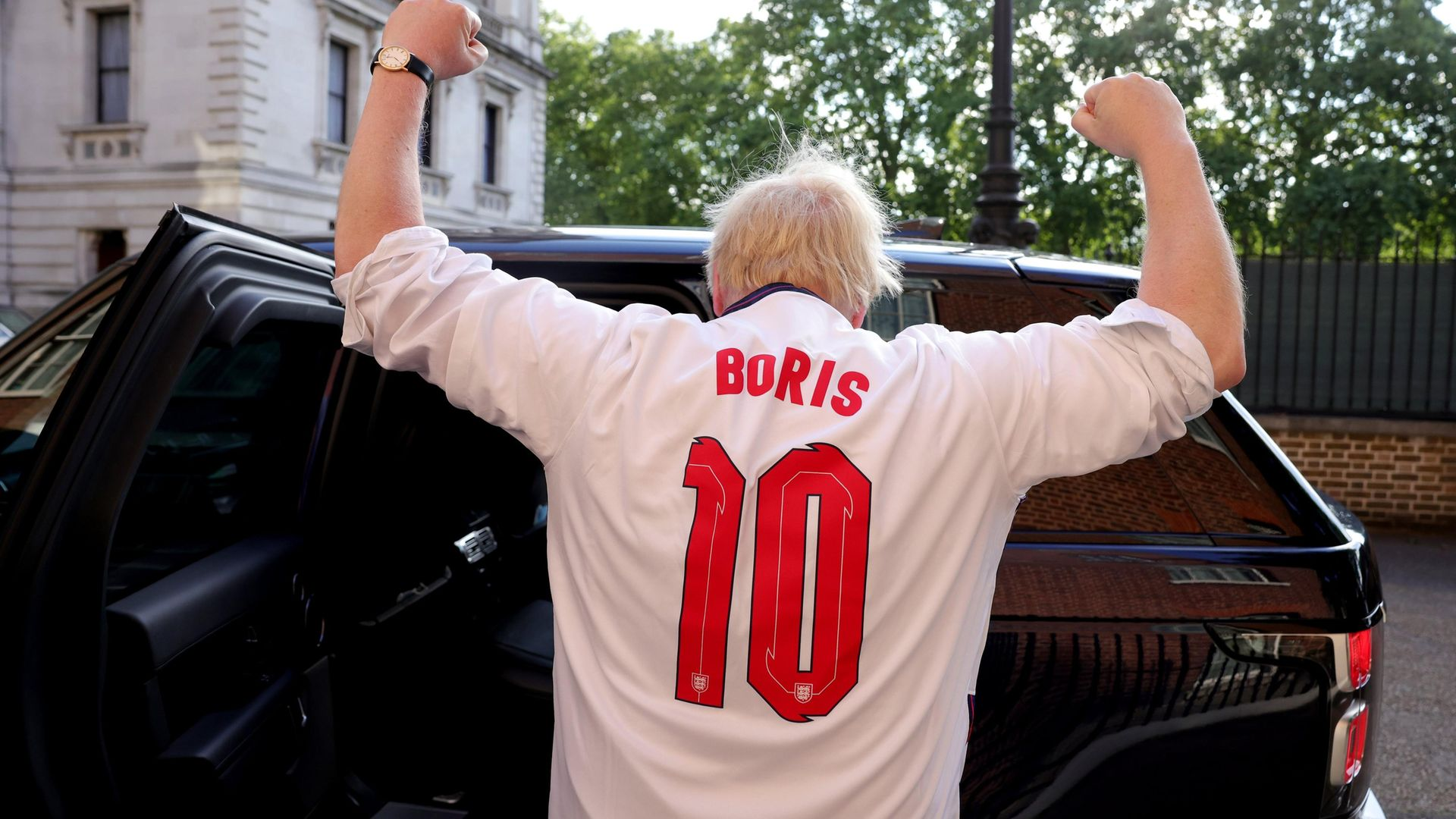 Boris Johnson, wearing an England top over his shirt, heads to Wembley for the semi-final against Denmark - Credit: Twitter