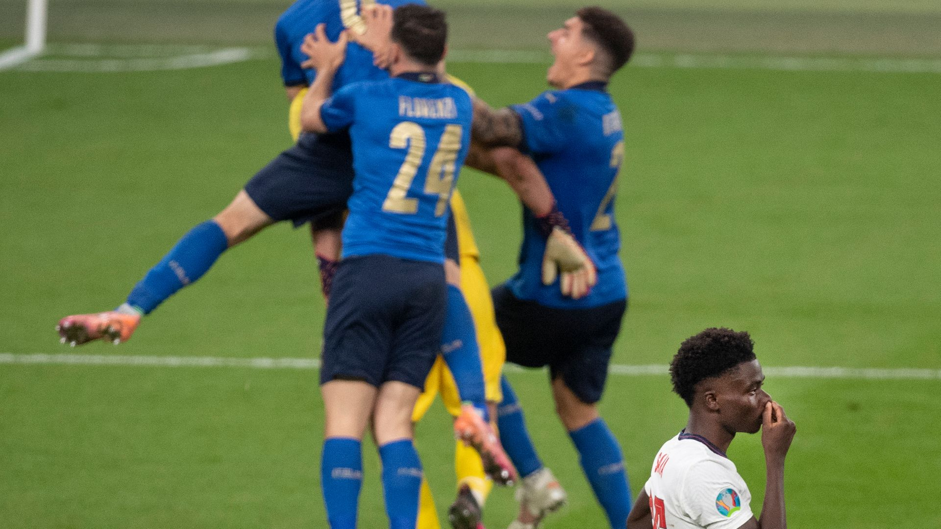 Italy celebrate in front of Bukayo Saka of England after he misses the crucial penalty of the shootout in the UEFA Euro 2020 Championship final - Credit: Photo by Visionhaus/Getty Images