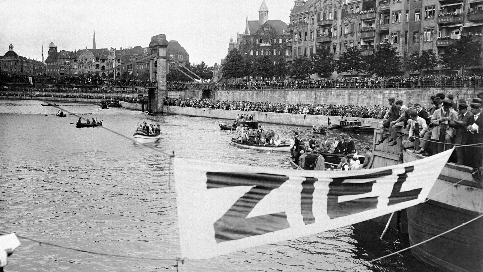 A city at play... Berliners flock to the river for a swimming event in the heart of the city in 1928 - Credit: Gamma-Keystone via Getty Images