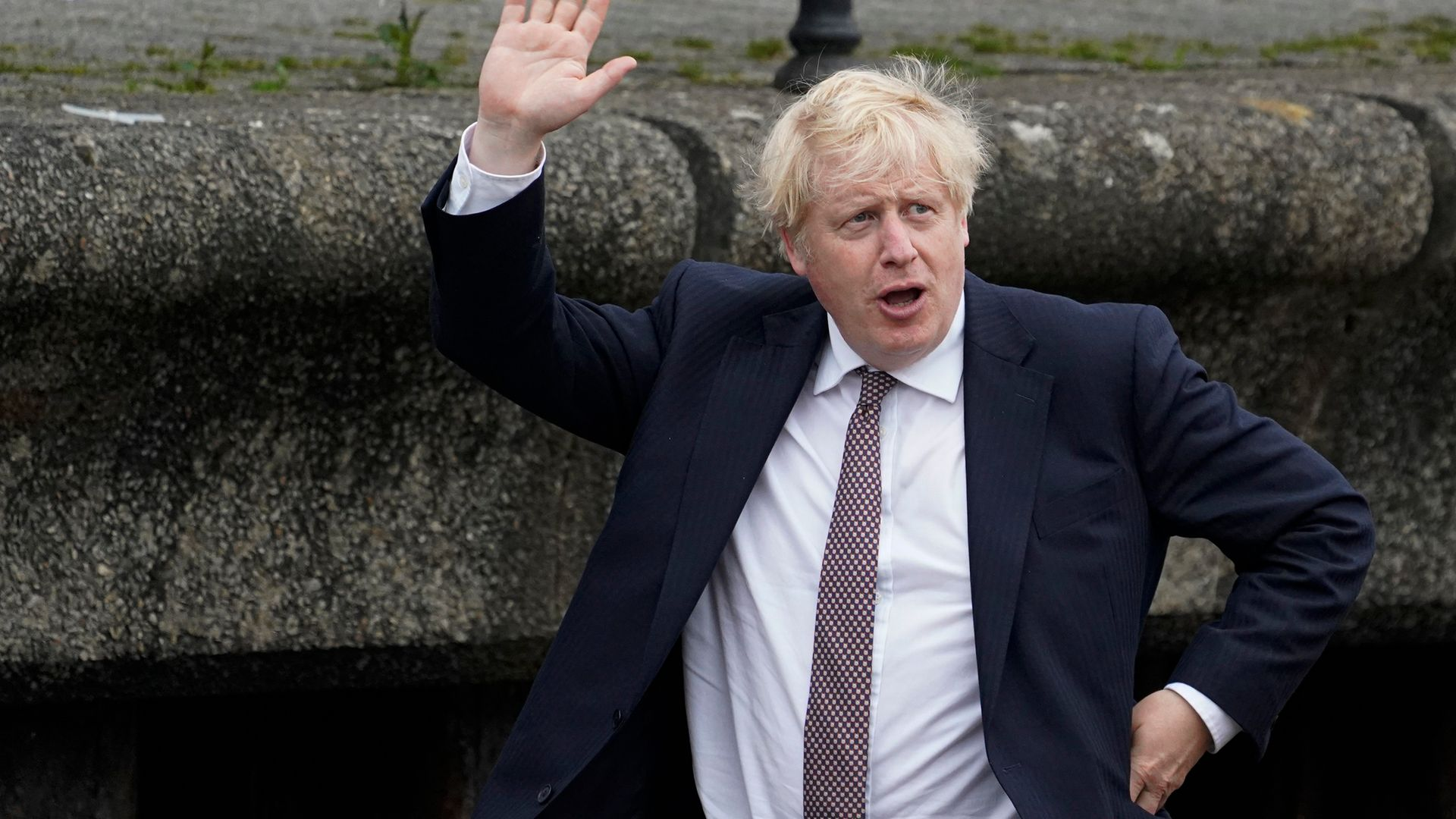 Boris Johnson waves to onlookers during a visit to Falmouth ahead of the G7 summit - Credit: Getty Images