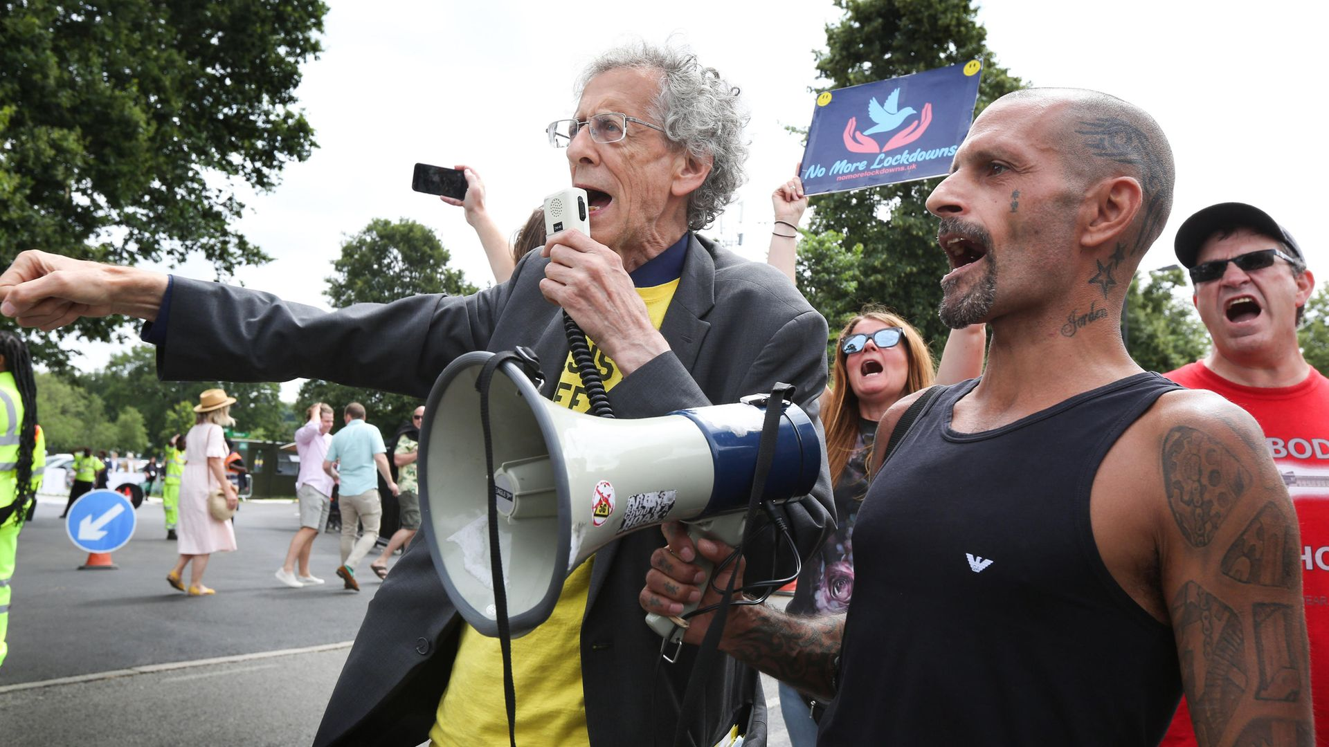 Anti-vaccine protestor Piers Corbyn speaks through a megaphone outside Centre Court on Wimbledon's Men's Finals Day - Credit: Photo by Martin Pope/SOPA Images/LightRocket via Getty Images