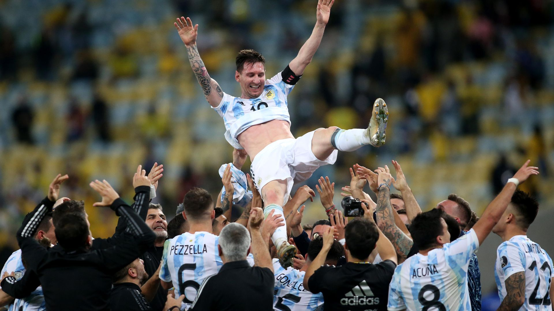 Argentina players throw Lionel Messi in the air after beating Brazil in the Copa America final - Credit: Photo by MB Media/Getty Images