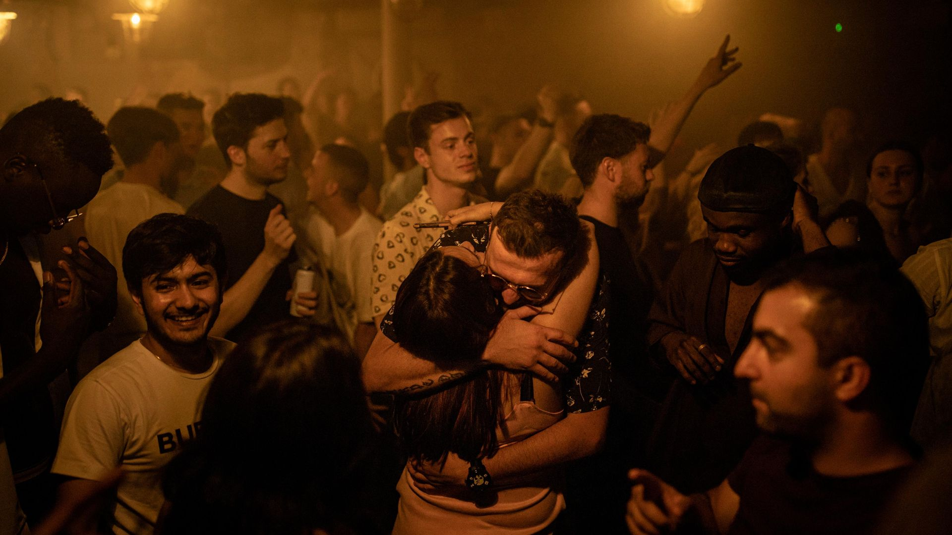 People hug in the middle of the dancefloor at Egg London nightclub as England drops most of its remaining Covid-19 social restrictions - Credit: Getty Images