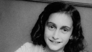 Anne Frank laughing for her school photographer at the Joods Lyceum (Jewish High School) Amsterdam, December 1941