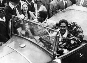 Erika Mann behind the wheel, with codriver Ricki Hallgarten, after finishing a 1,000km race in Rome, in 1931. Credit: ullstein bild via Getty Images