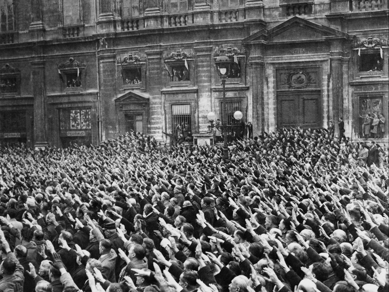 The chilling sight of a huge group of locals performing the Hitler salute in Vichy, 1940Photo: Keystone-France/Gamma-Keystone via Getty Images.