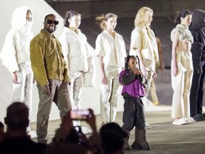 Kanye West and daughter North West on the runway of the Yeezy fashion show during Paris Fashion Week (Photo by Arnold Jerocki/GC Images)
