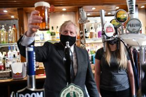 Bighead with a big head: Boris Johnson during a visit to The Mount Tavern pub and restaurant in Wolverhampton. Photo by Jacob King/POOL/AFP via Getty Images.