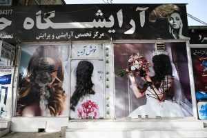 Images of women on the facade of a beauty salon in Shar-e-Naw, Kabul are defaced as the Taliban arrive to retake the city. Photograph: Wakil Koshar/AFP/Getty Images.