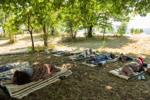 Competitors lie down during the traditional 'laziness contest' near Niksic, MontenegroPhoto: Milos Vujovic/Anadolu Agency via Getty Images.