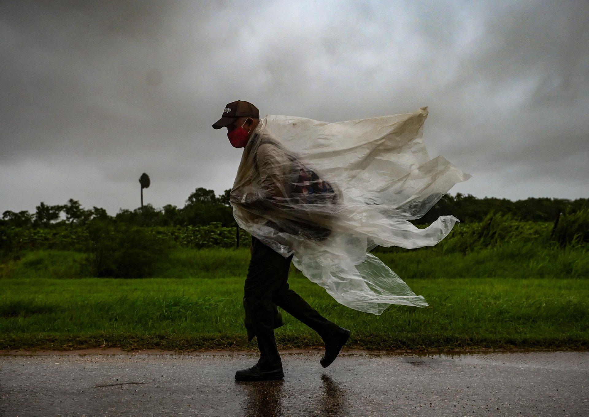 A man walks through the rain in Batabano, Mayabeque province as Hurricane Ida passes through eastern Cuba. Photo: Getty Images.