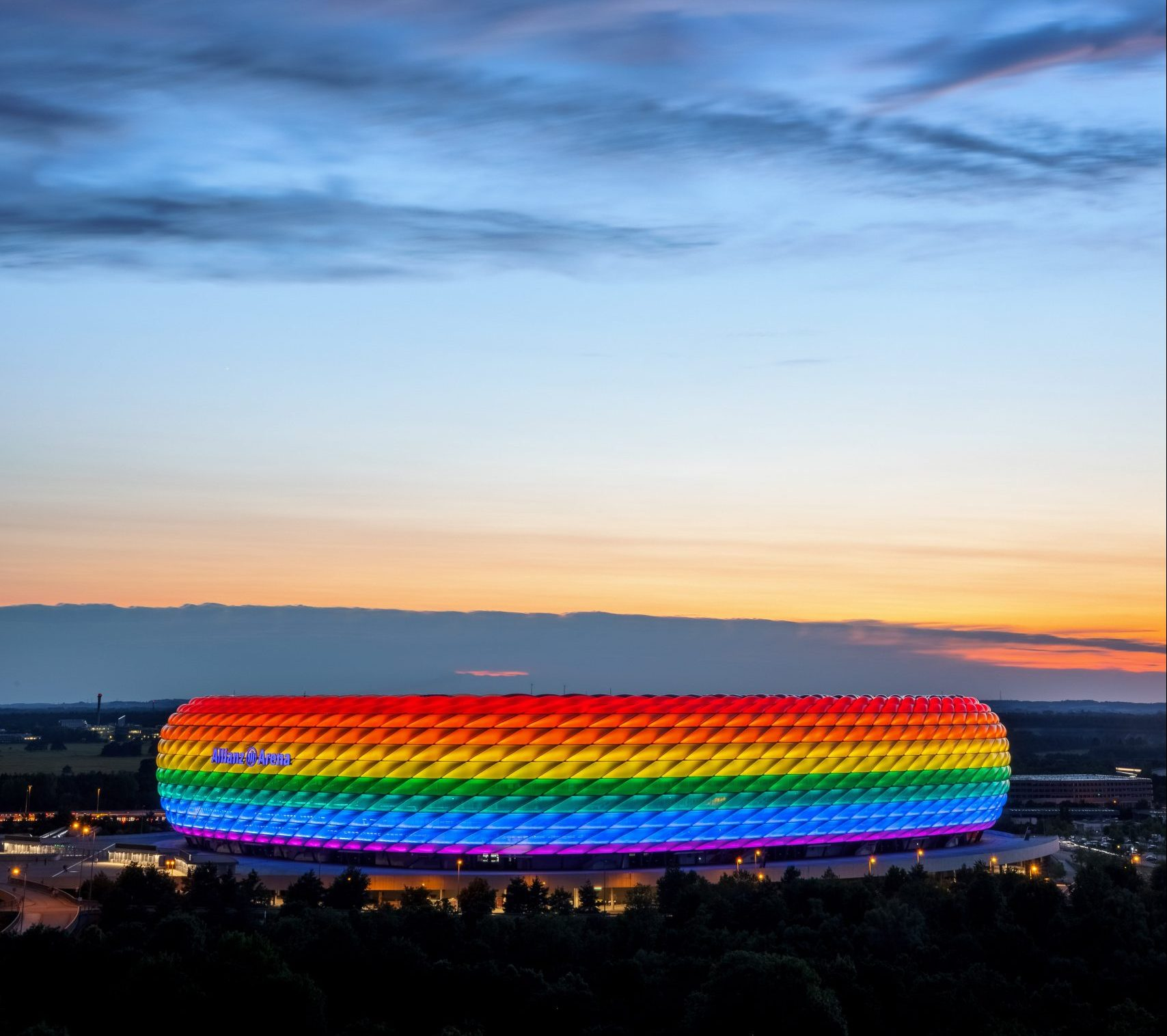 Three weeks after plans to light up Munich's Allianz Arena in rainbow colours caused a major international row, the stadium has finally got the multi-coloured treatment