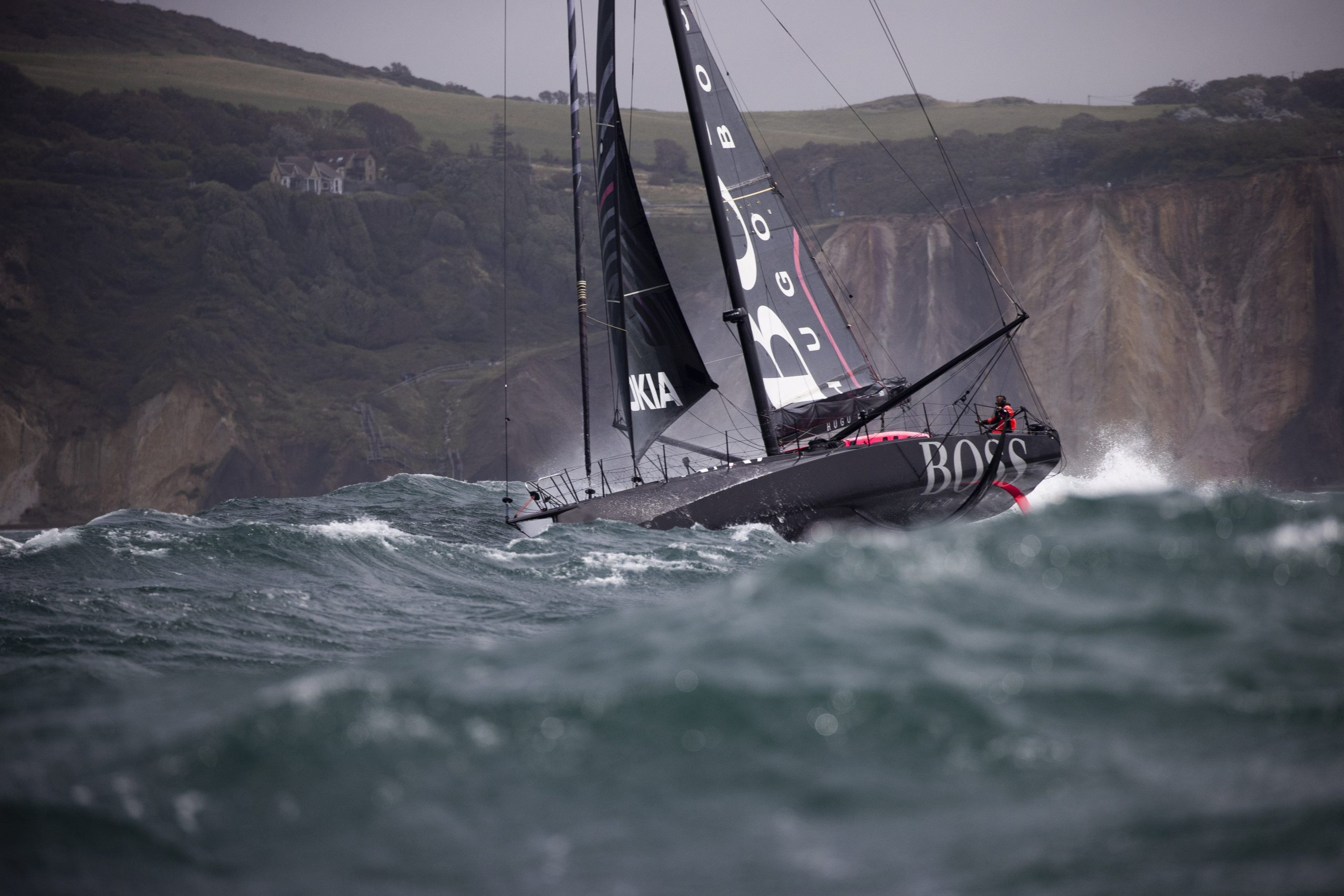 A yacht taking part in the Fastnet Race battles stormy seas near the start line off the Isle of Wight.