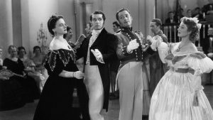 Maureen O'Sullivan, Laurence Olivier, Edward Ashley and Greer Garson on the dancefloor in the 1940 film version of Pride And Prejudice
