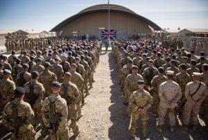 British troops and service personal gather for a Remembrance Sunday service at Kandahar Airfield, November 2014. Photo by Matt Cardy/Getty Images