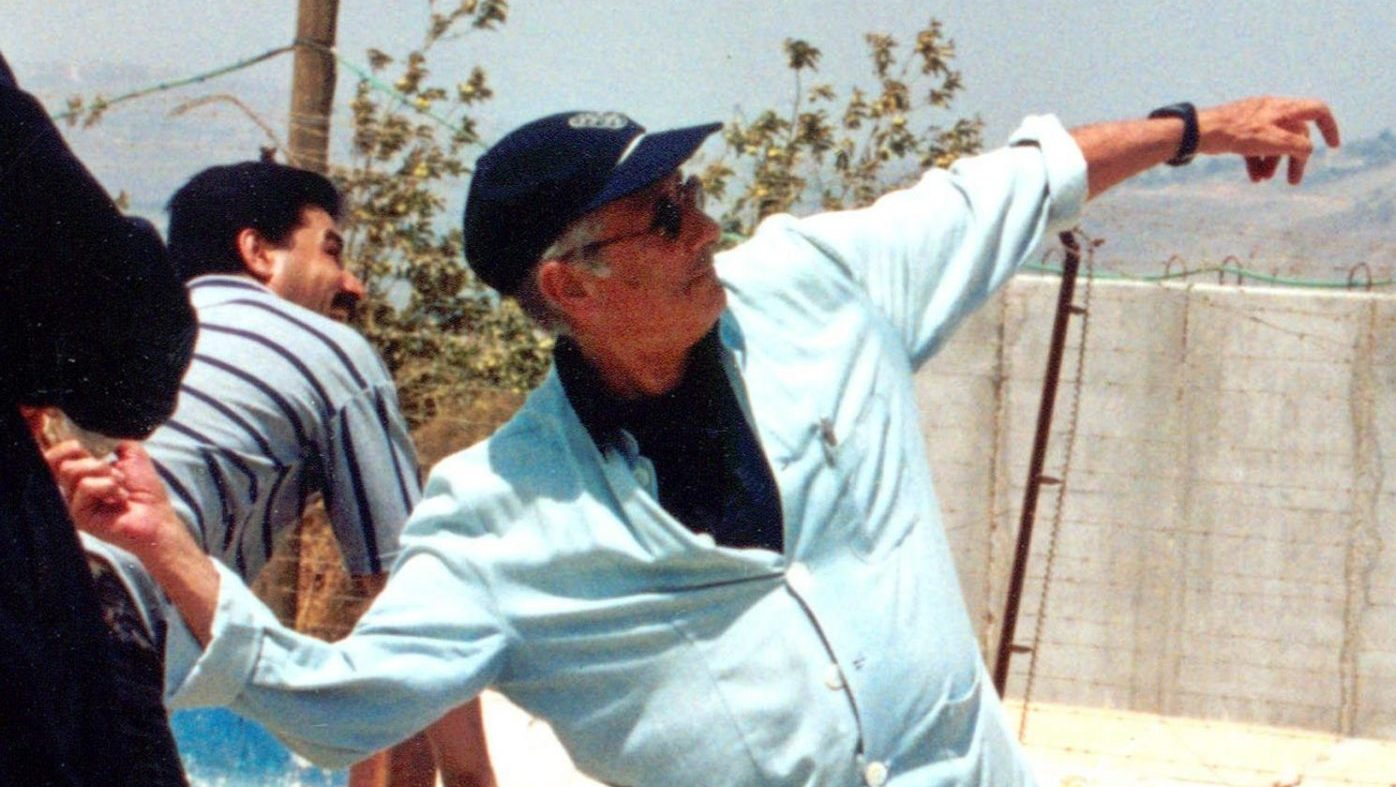 Said throws a stone across Lebanon's border with Israel in the southern village of Kafr Kila, July 2000. The academic claimed his act was a symbolic expression of joy after Israeli withdrawal from southern Lebanon  and that the nearest Israeli soldier was half a mile away