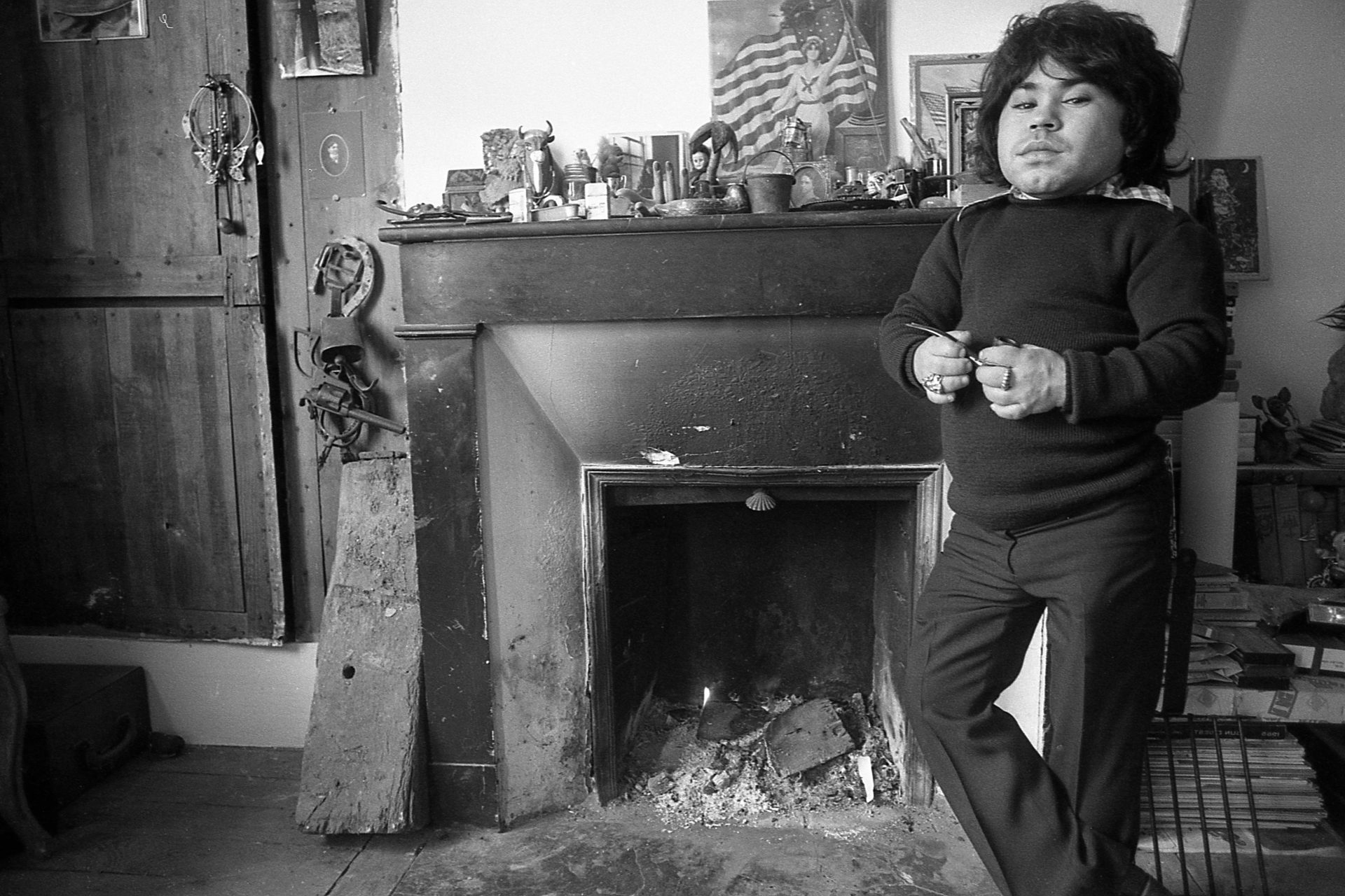 Herve Villechaize at home in his apartment in Paris; circa 1973. Credit: Nik Wheeler/ Corbis via Getty Images