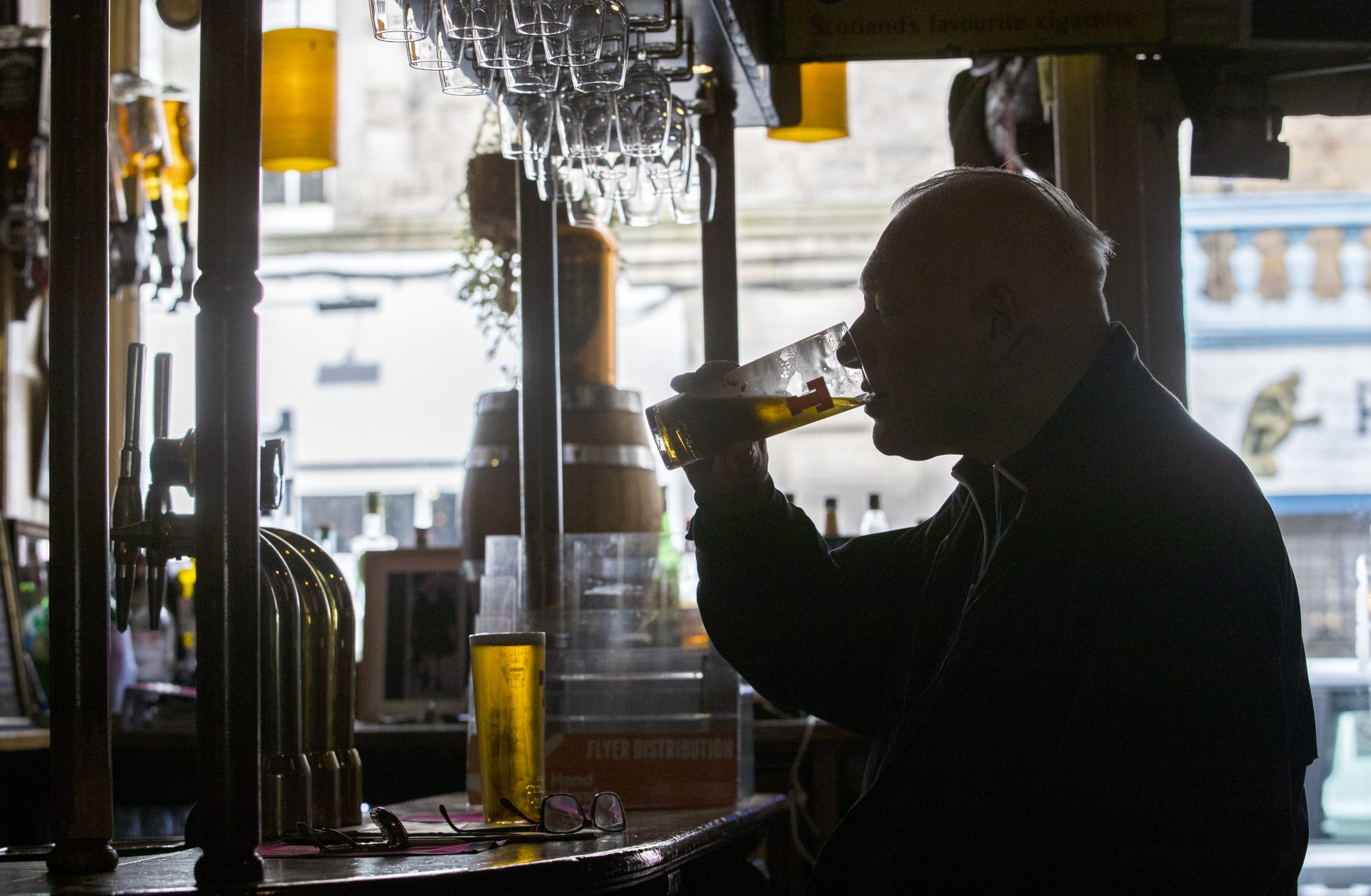 A customer at the Waverley, Edinburgh, enjoys a drink at the bar. Alcohol can now be served inside pubs and restaurants, which are allowed to stay open until 22.30, as Scotland moves to Level 2 restrictions to ease out of lockdown. Credit: Jane Barlow/PA Wire/PA Images