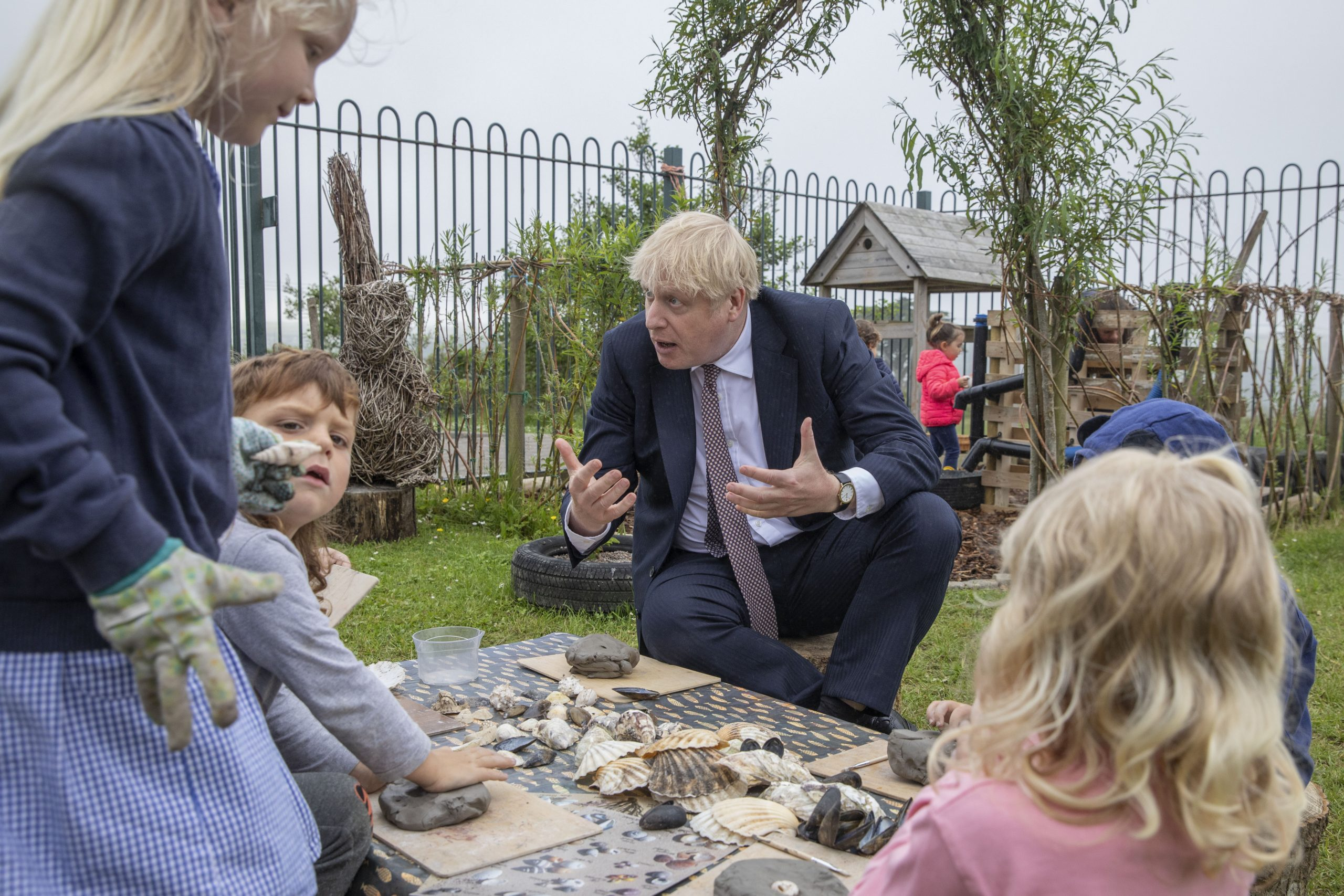 Prime Minister Boris Johnson talks with primary school children