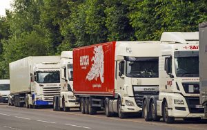 HGV lorries in a lay-by in Colnbrook, Berkshire, for their rest period. The Government has announced a temporary extension to lorry drivers' hours from Monday July 12th, amid a shortage of workers. Credit: Steve Parsons/PA Wire/PA Images