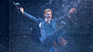 Despite spectacular effects, Adam Cooper can't recapture the magic of Gene Kelly and Stanley Donen's 1952 film version of Singin' in the Rain. Credit: Manuel Harlan