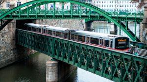 A U-Bahn train crosses Vienna's Zollamtsbrücke Truss Bridge while passing under the Zollamtssteg Arch Bridge. A change to a public transport term in Austria has prompted debate about language - Credit: Education Images/Universal Image