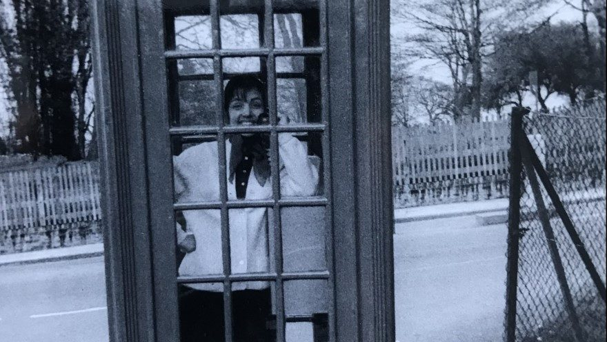 Patrick Sawer's mother, Pina, in her first encounter with a red telephone box, South London, 1966. Photo: Patrick Sawer
