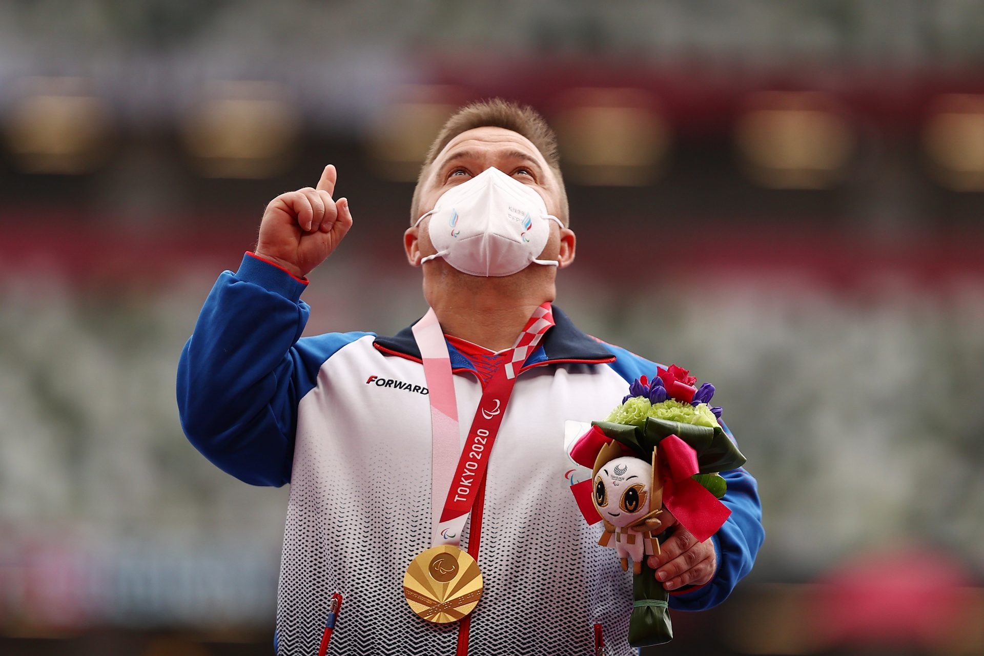 Russia's Denis Gnezdilov celebrates his paralympic shot put gold medal to the strains of Tchaikovsky. Credit: Lintao Zhang/Getty; Fine Arts/Heritage Pictures via Getty