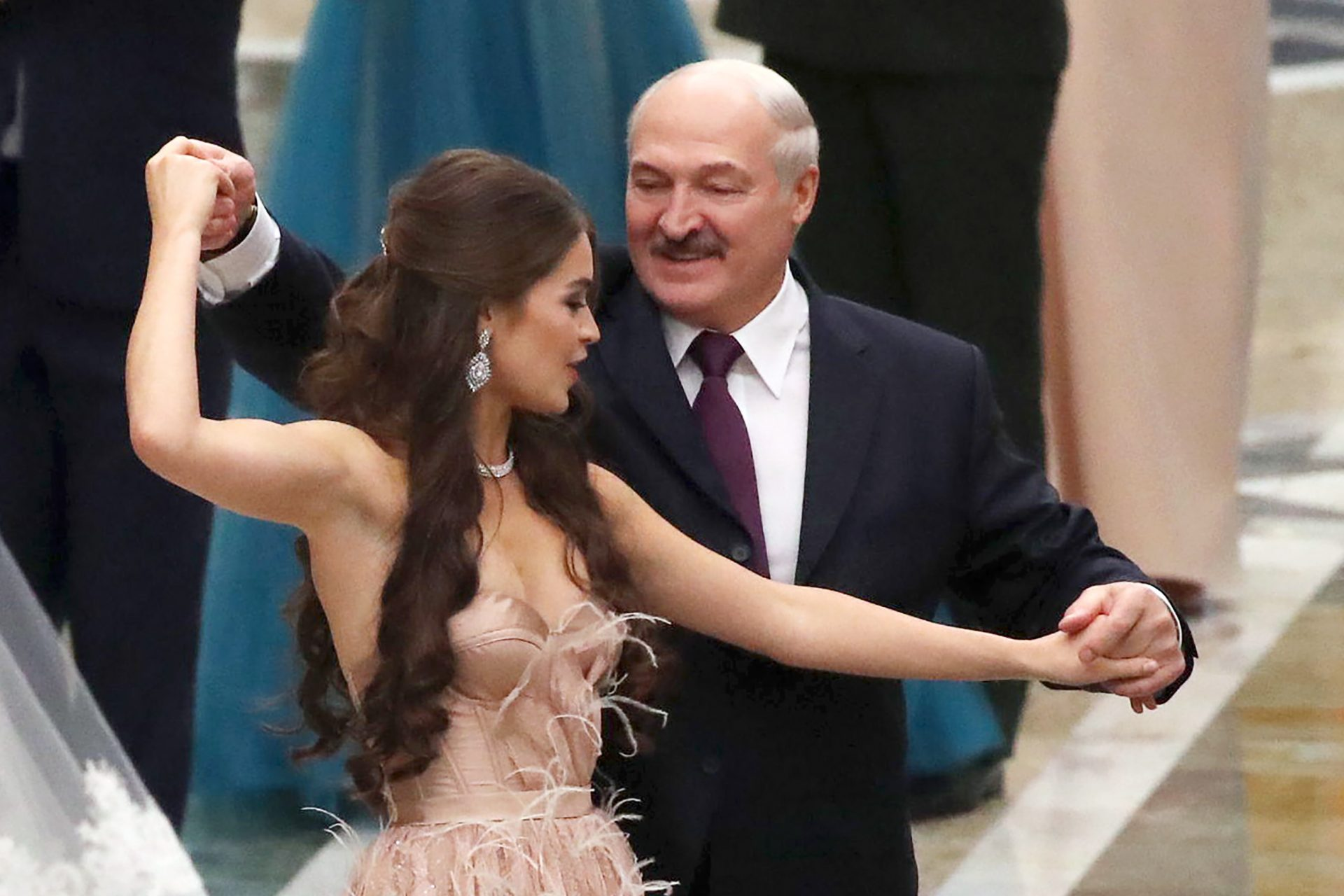 Miss Belarus 2018 Winner Maria Vasilevich (L) and Belarus' President Alexander Lukashenko dance at the republican Christmas youth ball. Photograph: Maxim Guchek/Getty Images.