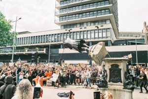 Black Lives Matter protesters topple the statue of slave owner Sir Edward Colston In Bristol, June 2020. The incident became a worldwide touchstone for what is seen by some as a battle of generations. Photo: Harry Pugsley/Getty Images.