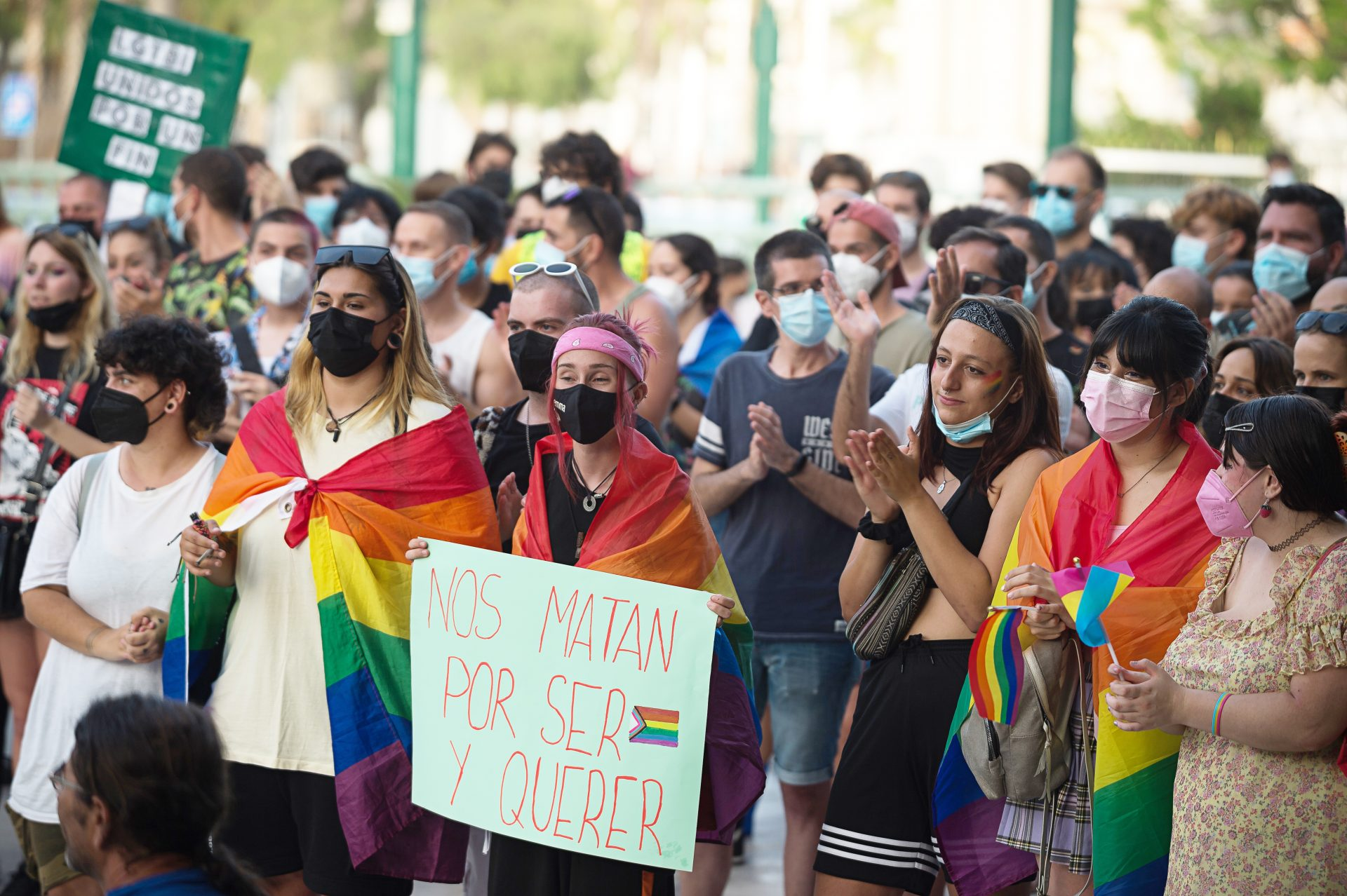 Protesters are seen wrapped in rainbow flags take part in a protest against homophobia and transphobia at Plaza de la Marina square after the homophobic murder of Spanish 24 year-old Samuel Luiz. (Photo by Jesus Merida/SOPA Images/LightRocket via Getty Images)