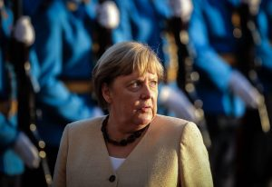 Merkel inspects a military guard of honour in Belgrade, Serbia, this month – on one of her final duties before the election. Photo: OLIVER BUNIC/AFP via Getty Images