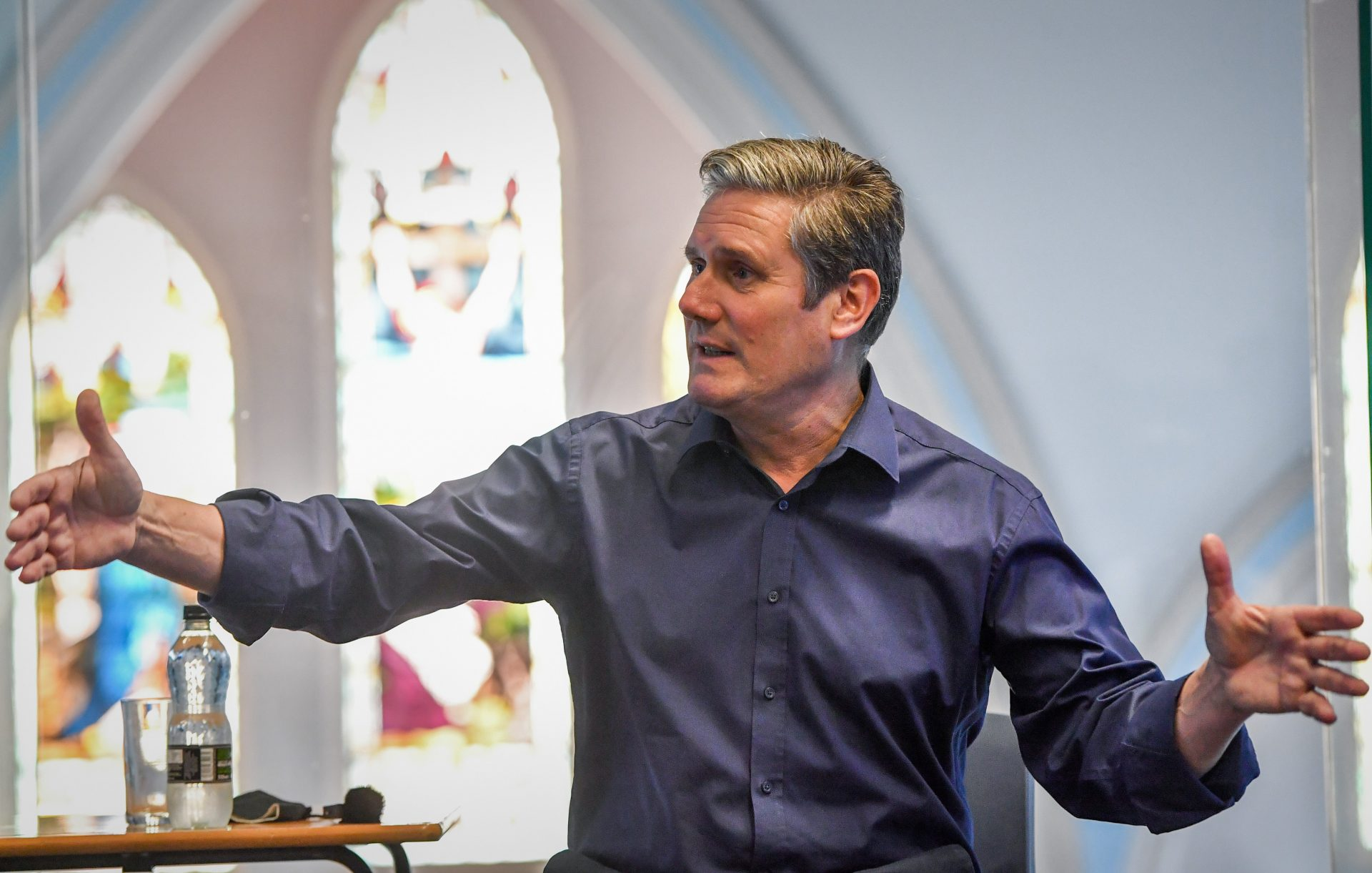 With a stained glass window in the background, Labour leader Sir Keir Starmer meets A-Level students at a Catholic academy in Blackpool Photo: Anthony Devlin/Getty Images