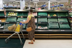 Brexit has made empty or depleted supermarket shelves a common sight. Here, a shopper in Cardiff weighs up the remaining choices. Photo: Charles McQuillan/Getty Images