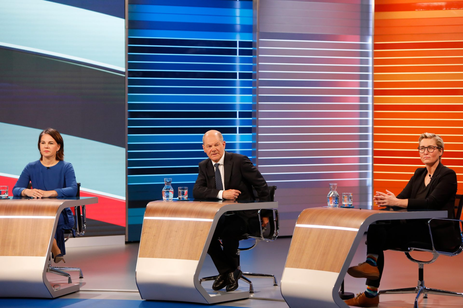 Annalena Baerbock, chancellor candidate of the German Greens Party, Olaf Scholz, chancellor candidate of the German Social Democrats (SPD) and Susanne Hennig-Wellsow (L-R), co-lead candidate of Die Linke are pictured ahead of a televised discussion at an ARD/ZDF studio following initial results. (Photo by Michele Tantussi/Getty Images)